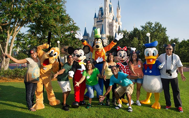 group of people having fun with Disney characters at Disneyland